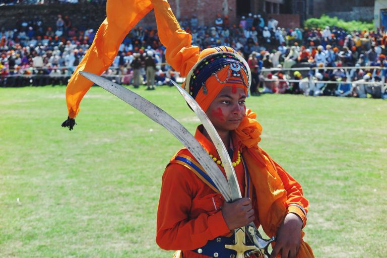 A young Sikh boy getting ready for the festivities at the Hola Mohalla Festival.